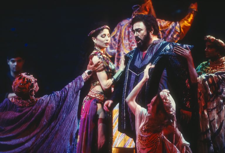 With other cast members, Italian tenor Luciano Pavarotti (1935 - 2007) performs as Calaf in the final dress rehearsal prior to the season premiere of the Metropolitan Opera/Franco Zefferelli production of 'Turandot' by Giacomo Puccini at the Metropolitan Opera House, New York, New York, May 9, 2000.