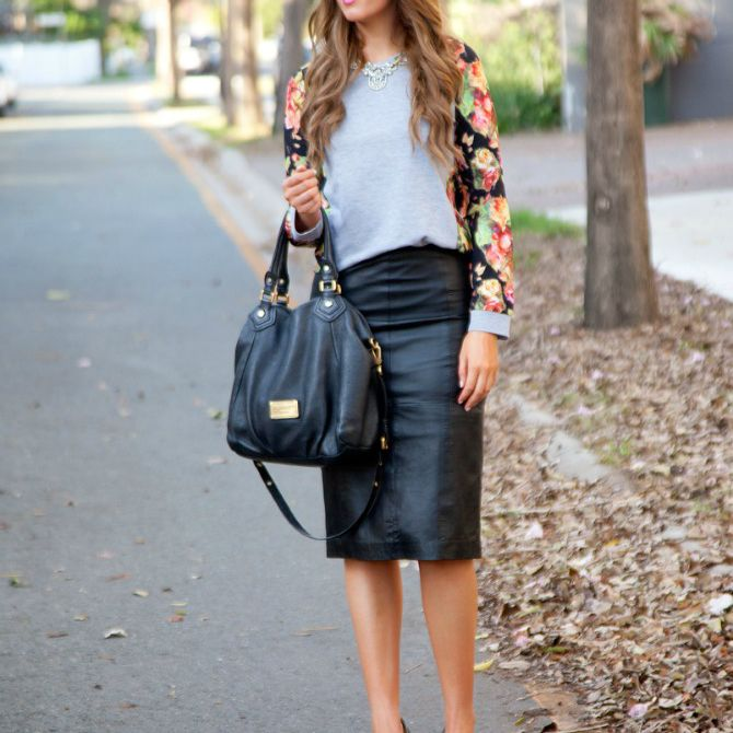 Woman in leather skirt and floral sweater for fall fashion