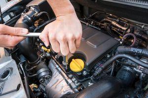 Cropped Image Of Man Repairing Car Engine