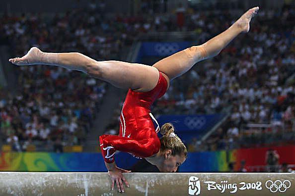 Gymnast Alicia Sacramone performs on beam at the 2008 Olympics