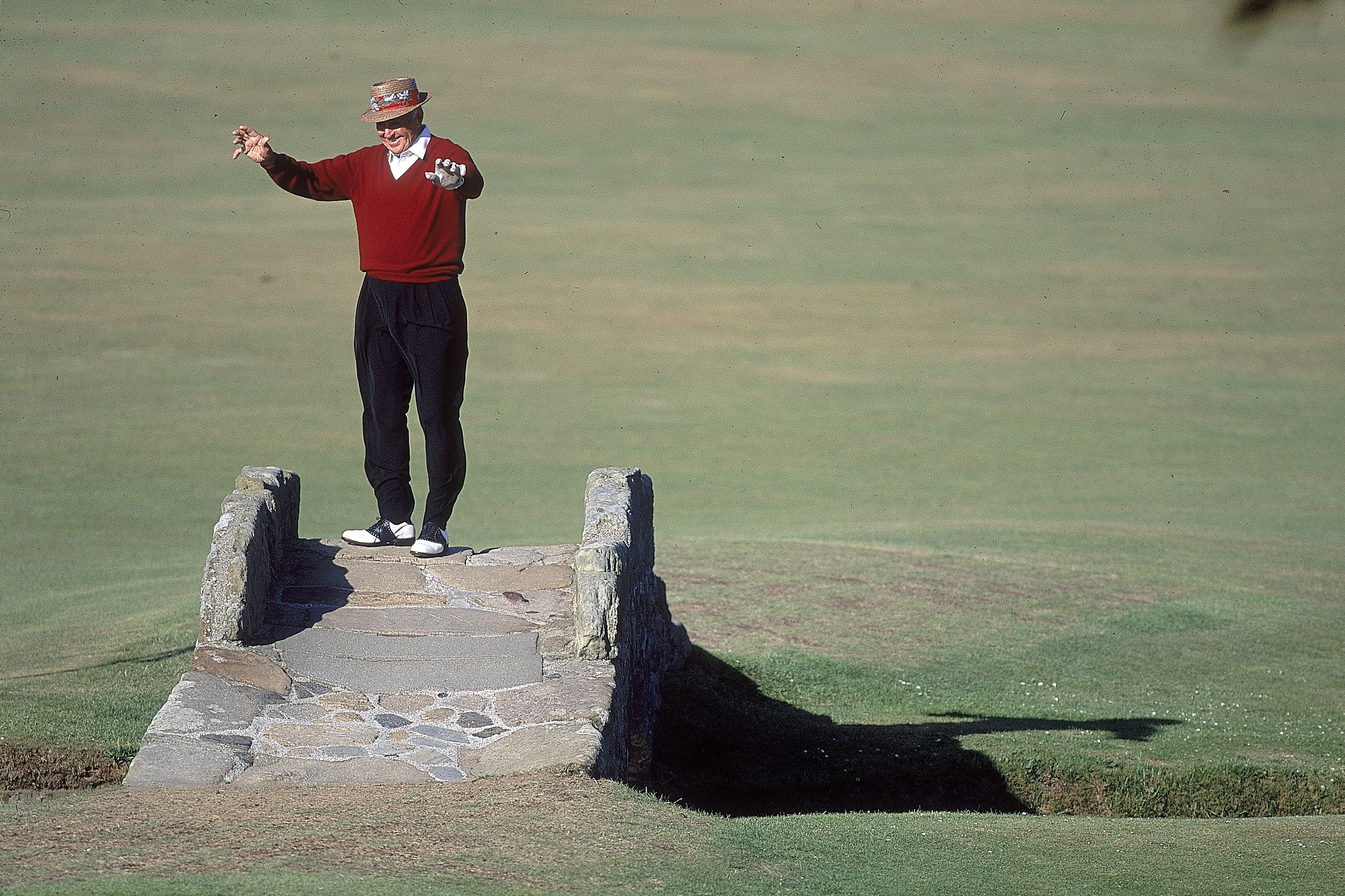 Sam Snead performs a little dance in his spikes on the Swilcan Bridge in 2000.