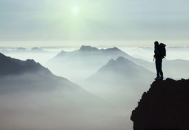 climber surveys the Mont Blanc region in Europe