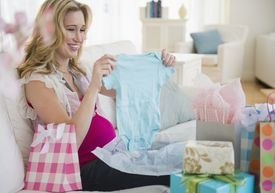 Pregnant woman unpacking baby gifts