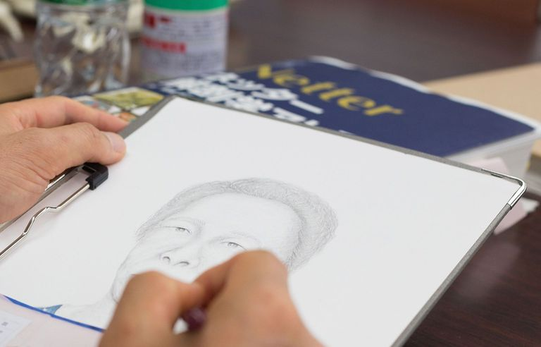 Forensic artist sketching face