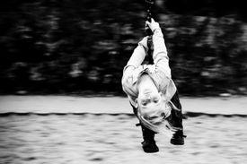 child swinging on a swing