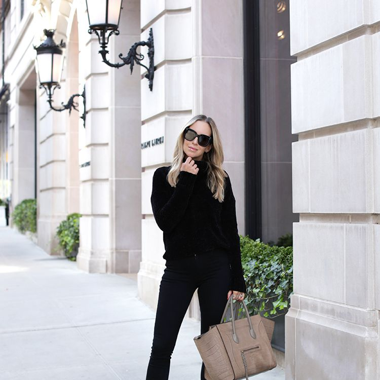 Woman in black outfit and white shoes
