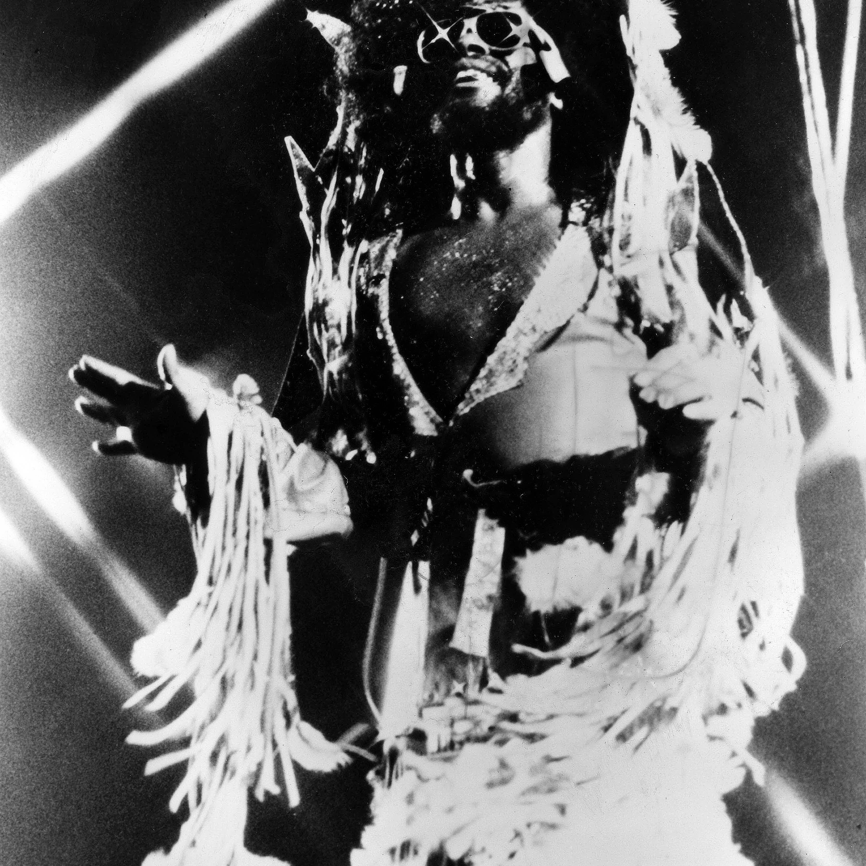 George Clinton singing on stage.