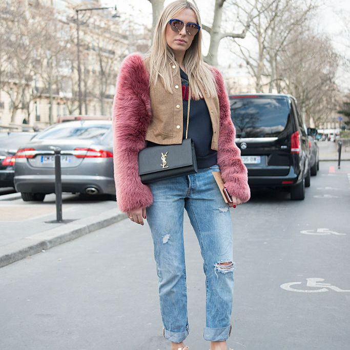 Street style photo of woman in jeans and faux fur