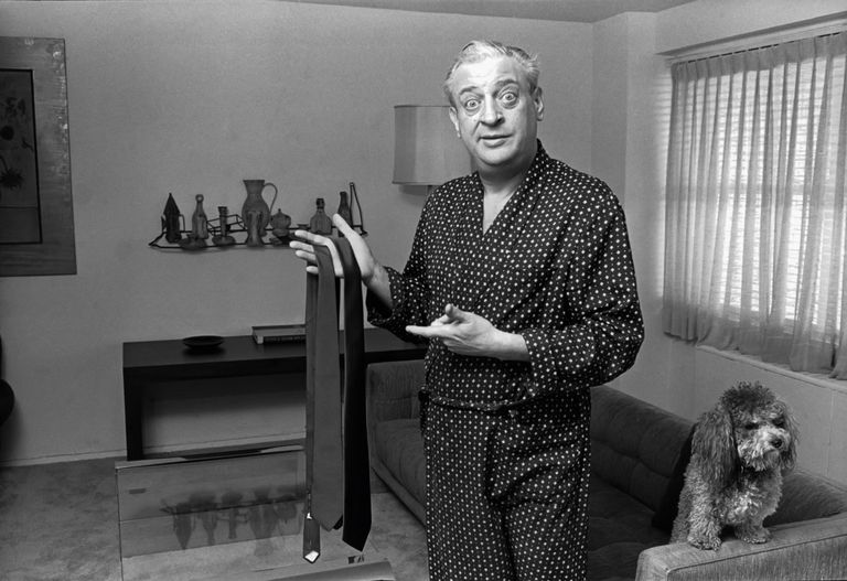 Rodney Dangerfield with his pet poodle