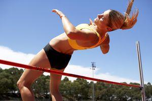 Female athlete doing high jump
