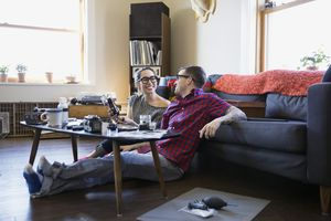 Couple sitting on floor together.