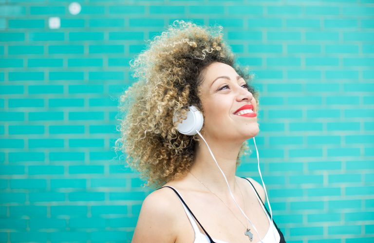 Joyful woman listening to music