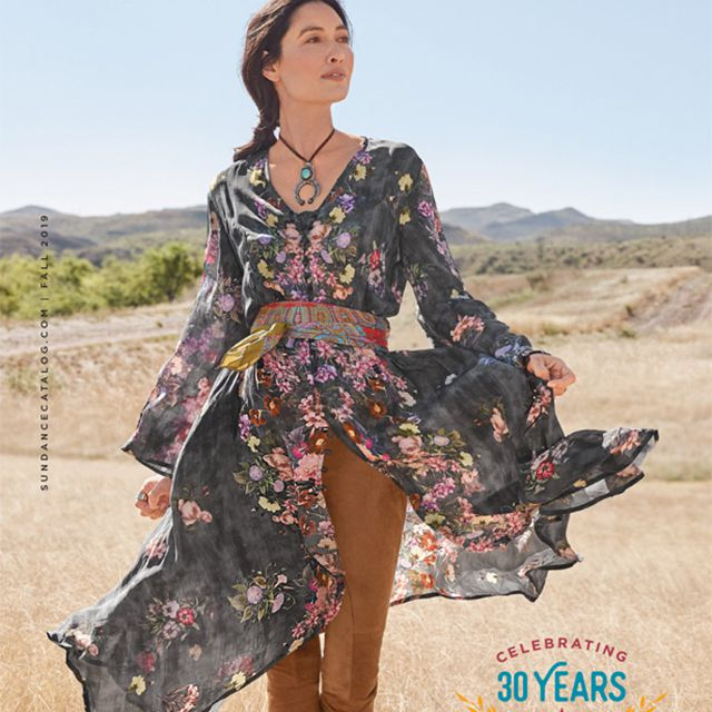 The cover of the latest Sundance catalog featuring a woman in a field wearing a dress