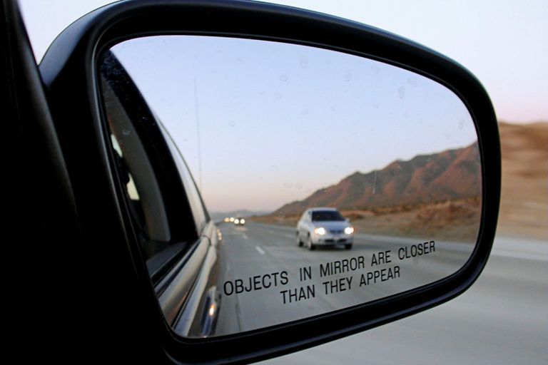 Car in rear view mirror