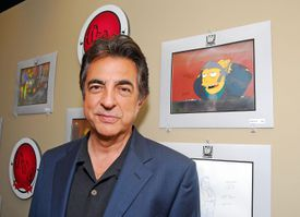 Joe Mantegna and an animation cel of Fat Tony