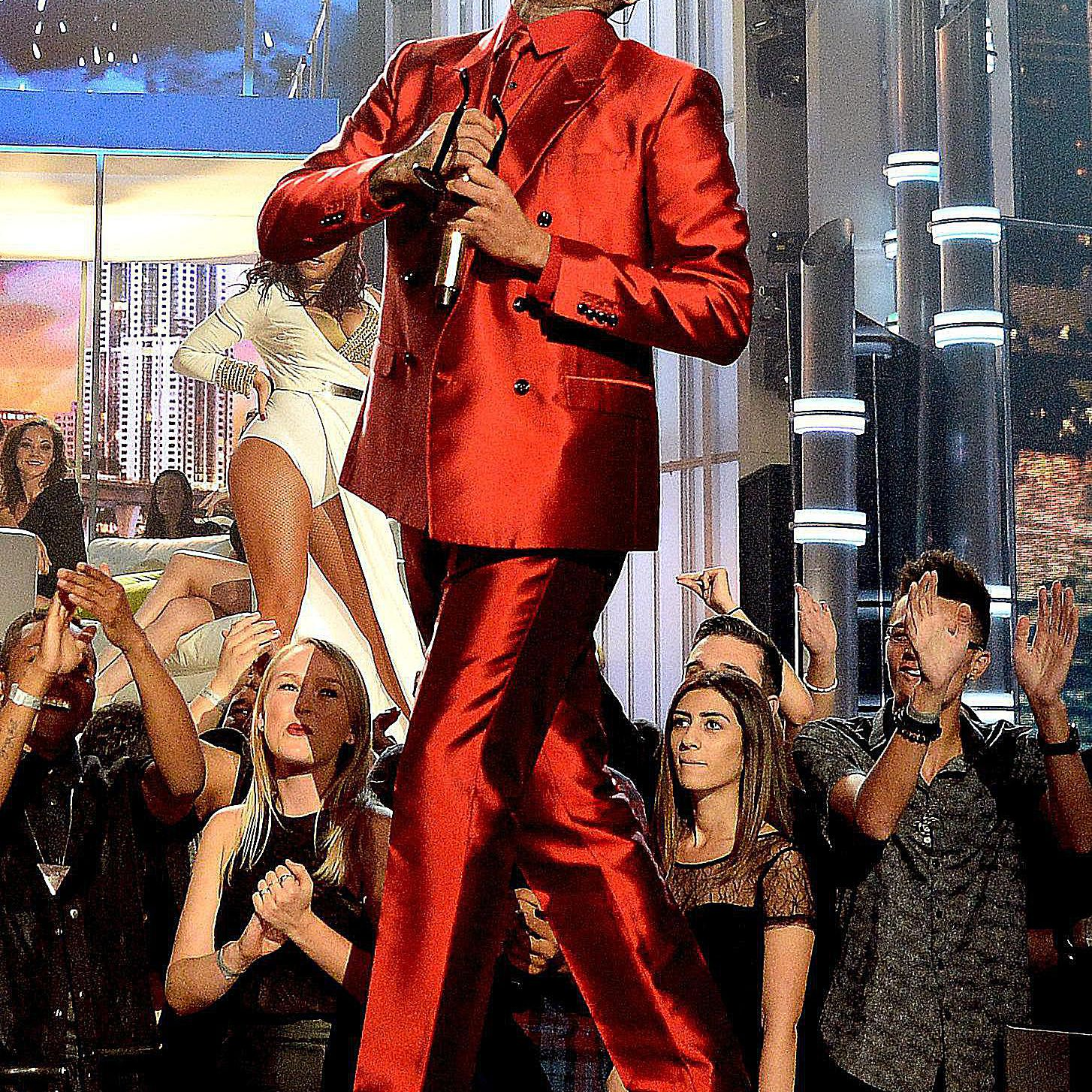 Chris Brown wearing a red suit