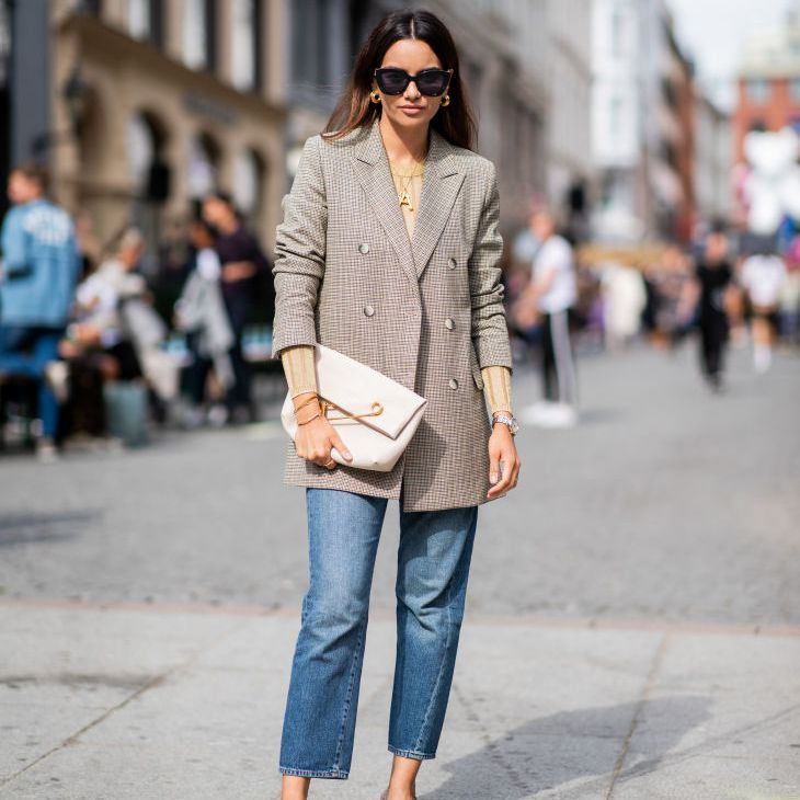 Street style woman in tweed blazer and cropped jeans