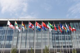 country flags in front of a building