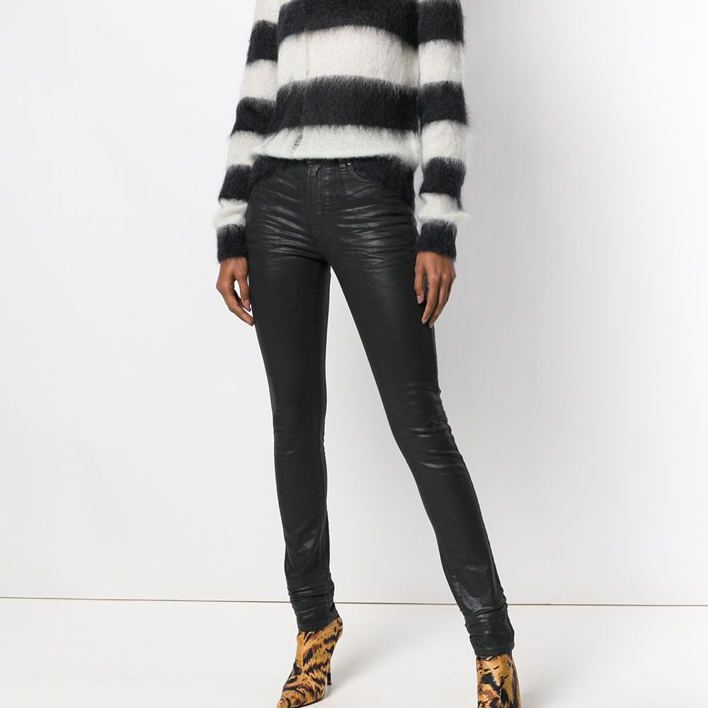 Woman in striped sweater and leather jeans