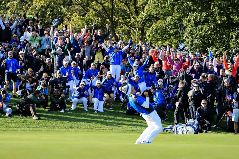 Team Europe celebrate as Suzann Pettersen of Team Europe putts to win her match and the tournament during the final day singles matches of the Solheim Cup at Gleneagles on September 15, 2019