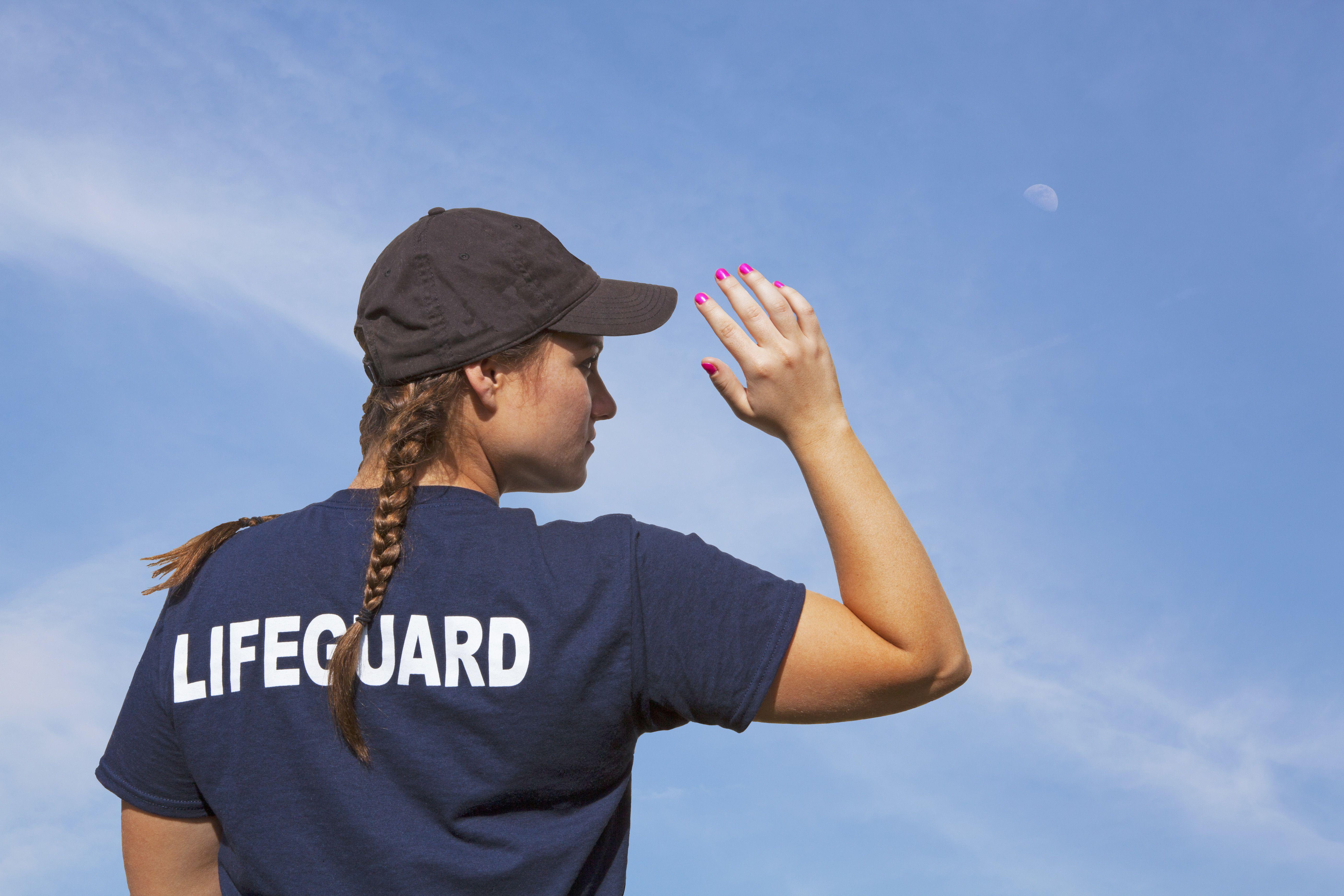 Lifeguard Girl On Duty Under a Blue Sky