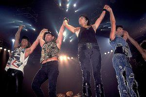 Bon Jovi waves to fans following a performance at Met Center on Bloomington, Minnesota, April 4, 1989.