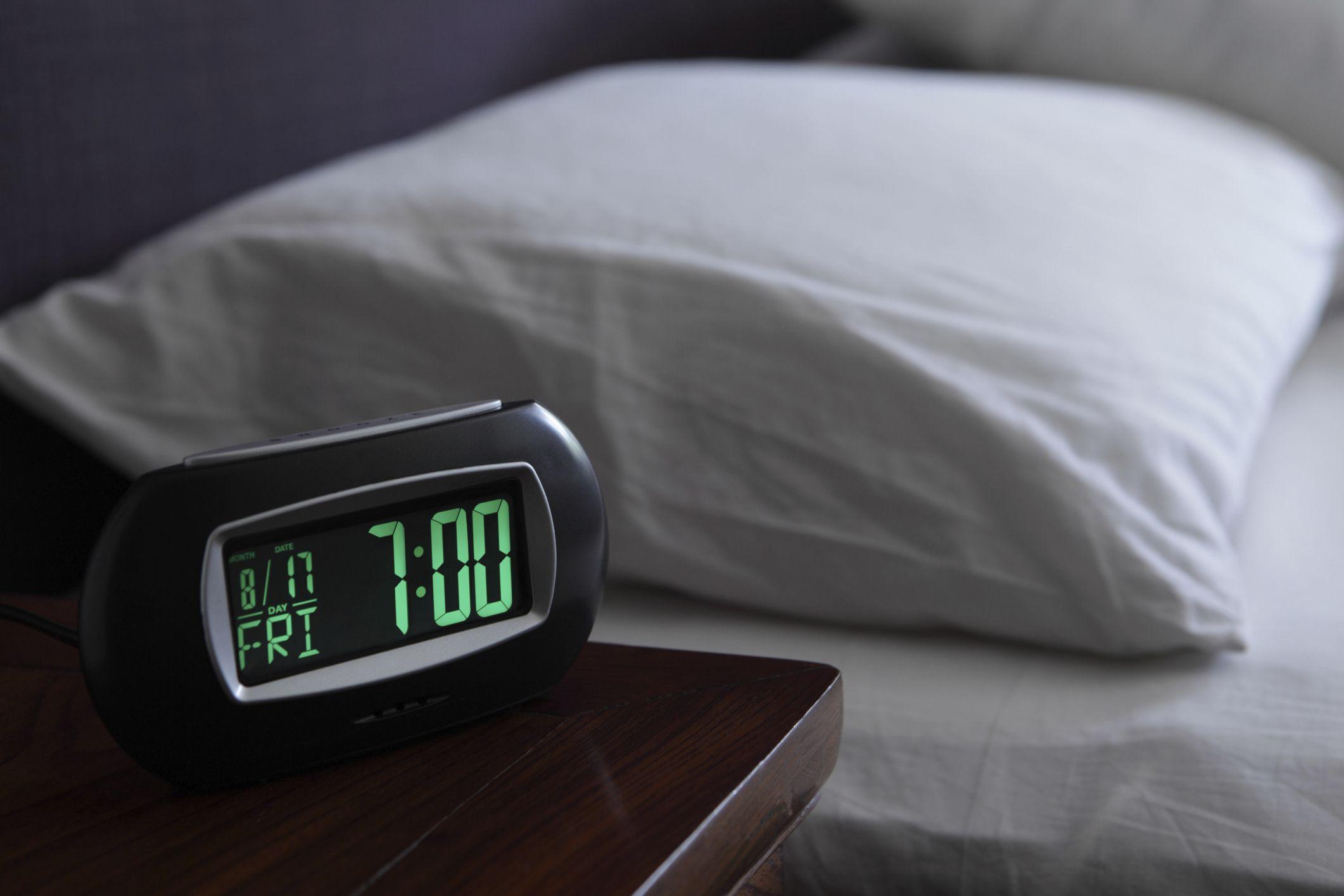 Alarm clock near bed
