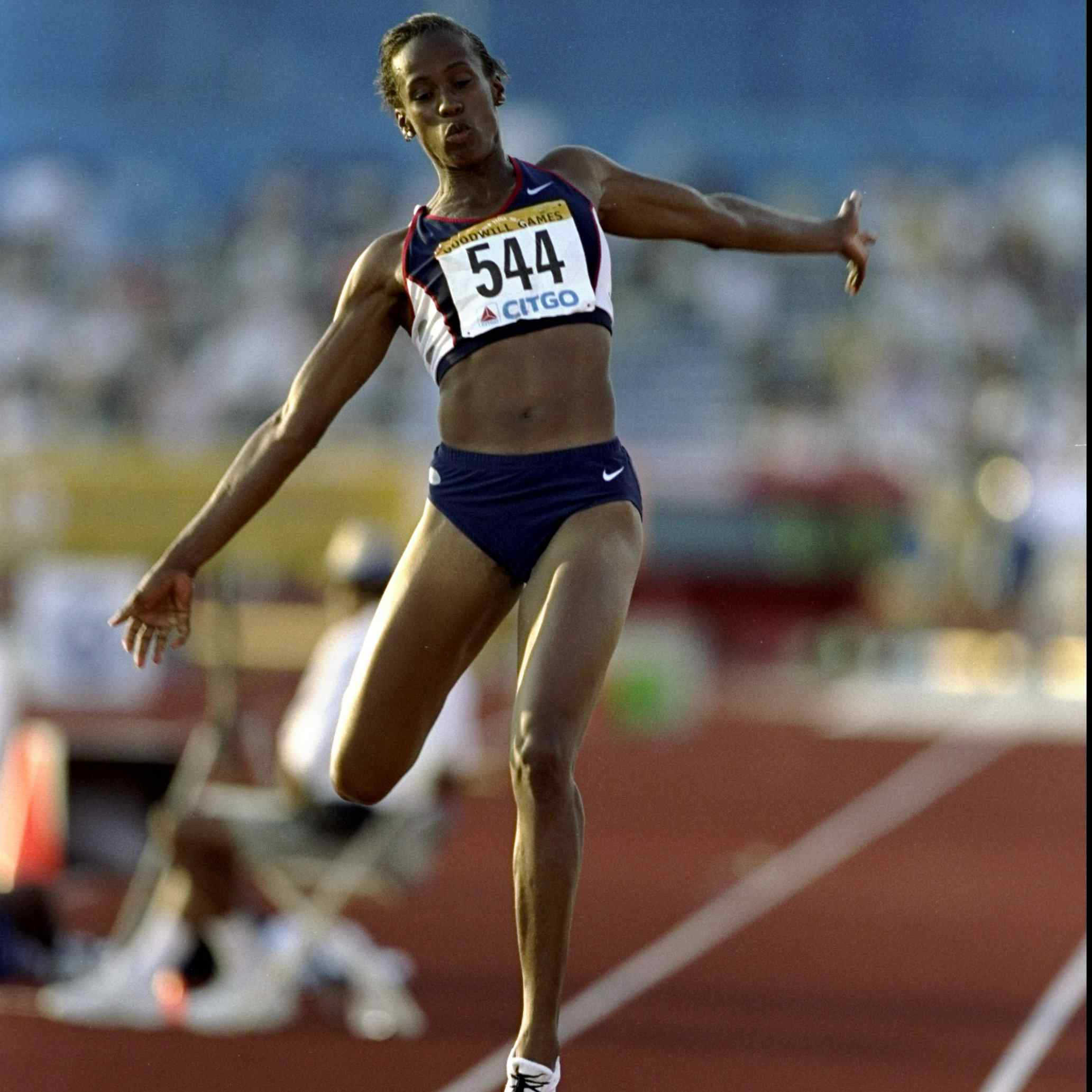 Jackie Joyner-Kersee #544 of the USA competes in the Long Jump