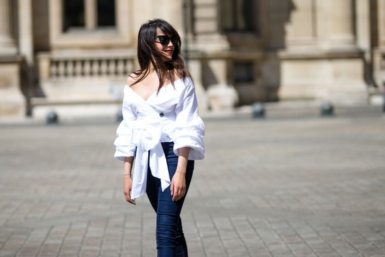 da4dff839ae6 French street style woman s fashion outfit in jeans and an off the shoulder  top
