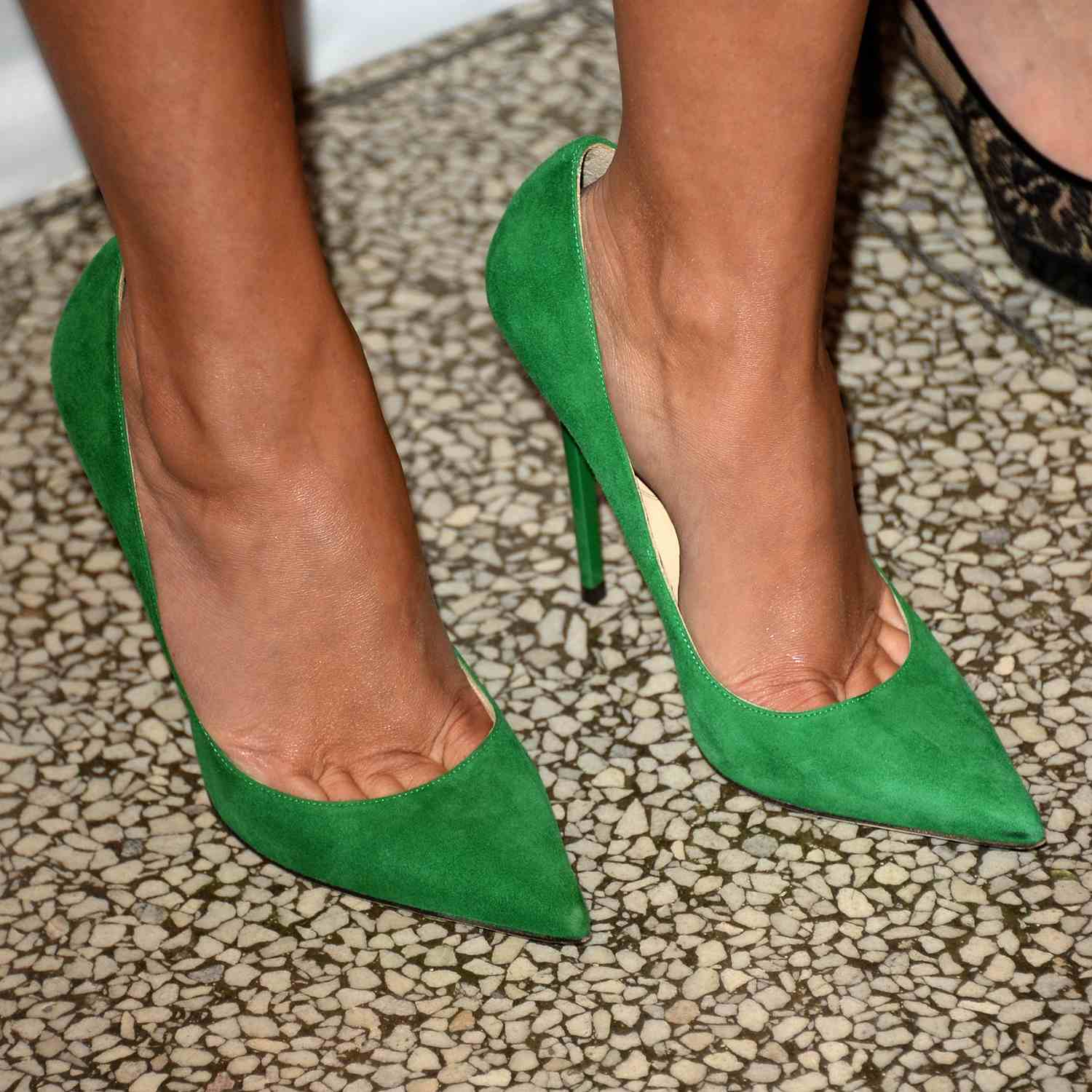ac831676b2 Close-up of green suede pumps, as worn by actress Reese Witherspoon.