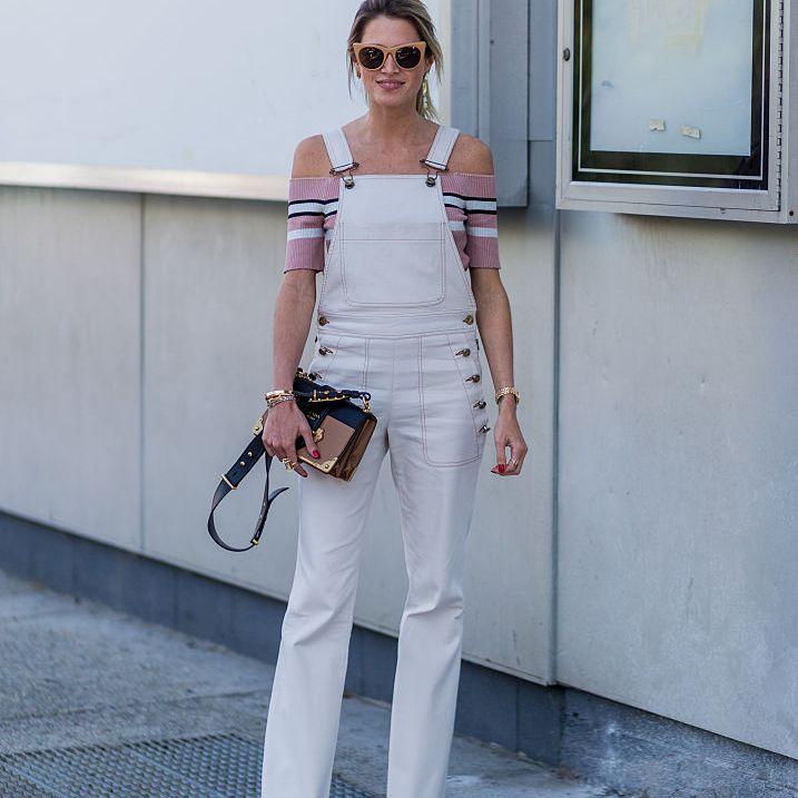 Street style fashion in white denim overalls
