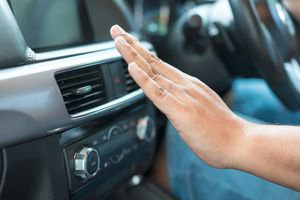 Vehicle dashboard controls and air vents with a hand feeling for air output