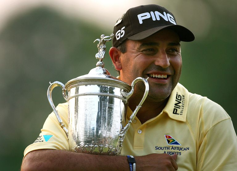 Angel Cabrera of Argentina hugs the trophy as he celebrates his one-stroke victory at the 107th U.S. Open Championship at Oakmont Country Club on June 17, 2007