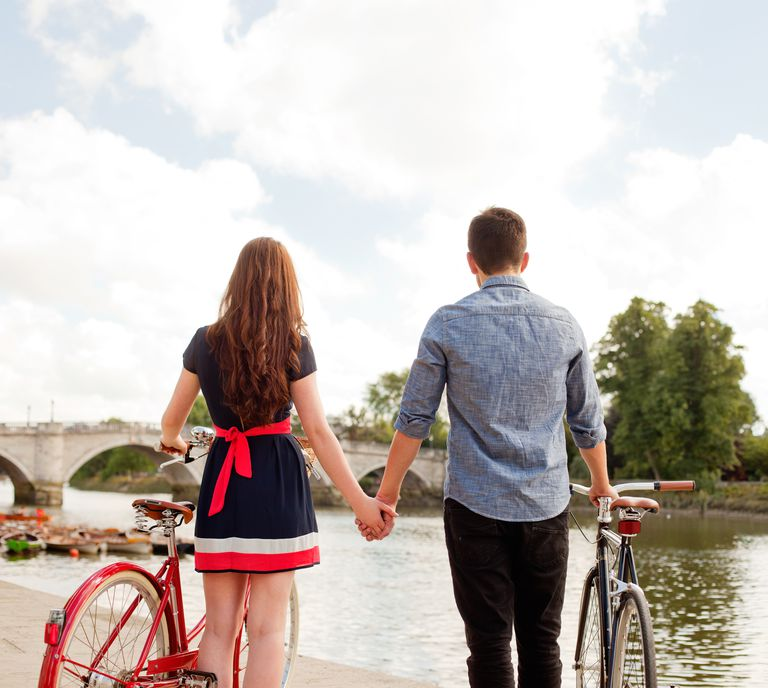 Couple With Bikes Looking At River View