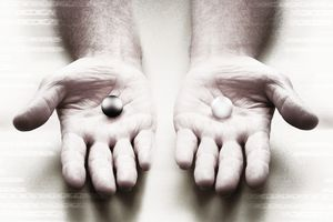Two hands holding different marbles - representing on the other hand