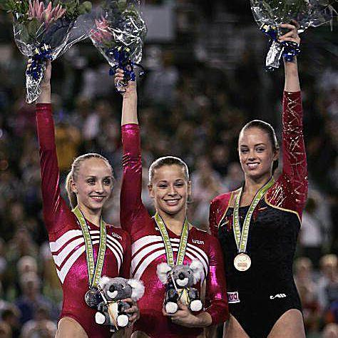 Nastia Liukin (USA), Alicia Sacramone (USA), and Suzanne Harmes (Holland) at the 2005 Worlds