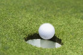 golf ball falling into the cup for a hole in one