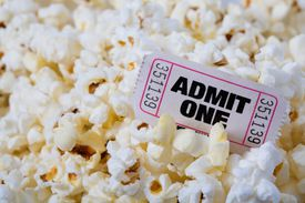 Image of a movie ticket in popcorn, illustrating About.com's Free Ticket Sweepstakes List.