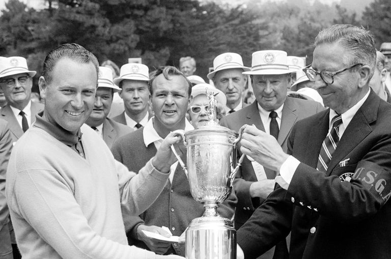 Billy Casper is awarded the US Championship Cup by USGA President William Foshay, as Arnold Palmer looks on. Casper won his second US Open in a playoff against Palmer in 1966.