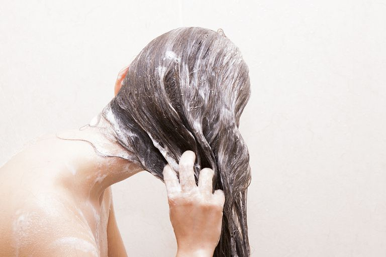 https://www.gettyimages.com/detail/photo/woman-washing-her-hair-royalty-free-image/177328587