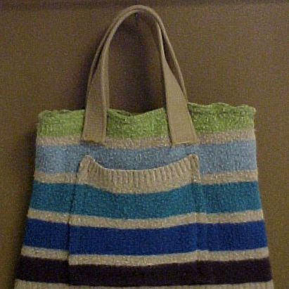 Sew handles on a sweater bag