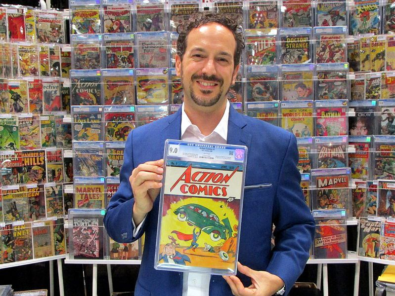 At the 2014 New York Comic Con, Vincent Zurzolo of Metropolis Collectibles displays the CGC 9.0 copy of Action Comics #1