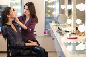 Makeup artist applying makeup