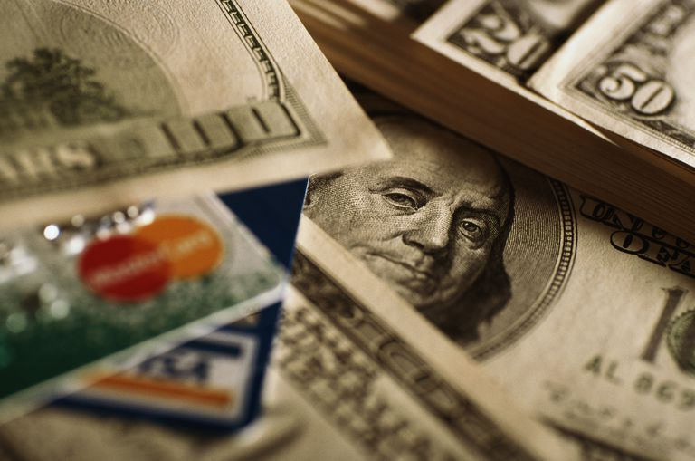 Different denominations of US currency and credit cards, close-up
