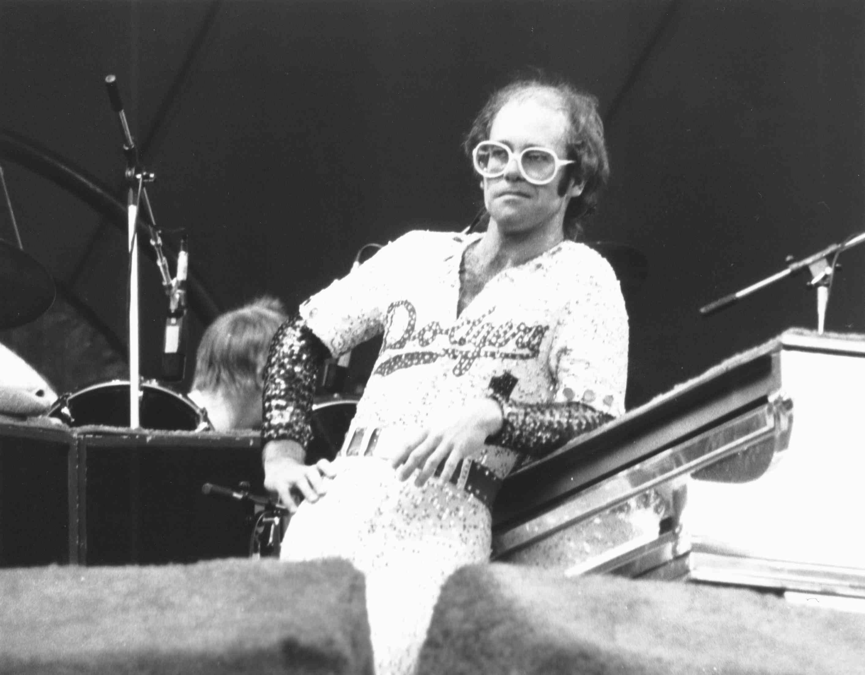 Elton John 1970s, big glasses, LA Dodgers shirt in sequins