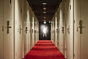 hotel hallway with figure at the end