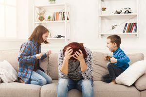 Kids having quarrel over tired mother