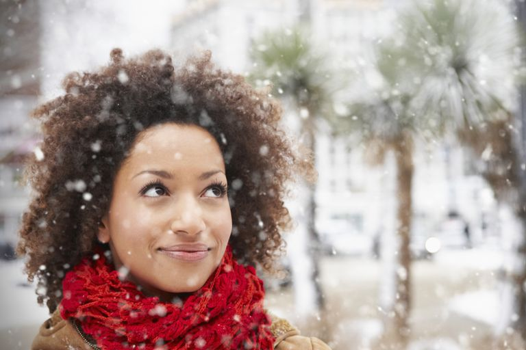 close-up of woman standing in the snow