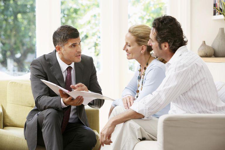 Salesman talking to couple
