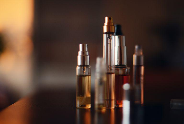 Multiple small bottles of perfume
